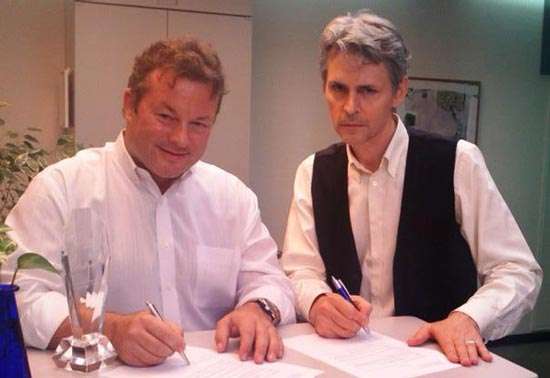 Dave Schaufele (left) and Guy Cihi (right) sign waivers permitting the use of their voice recordings for the Silent Hill HD Collection
